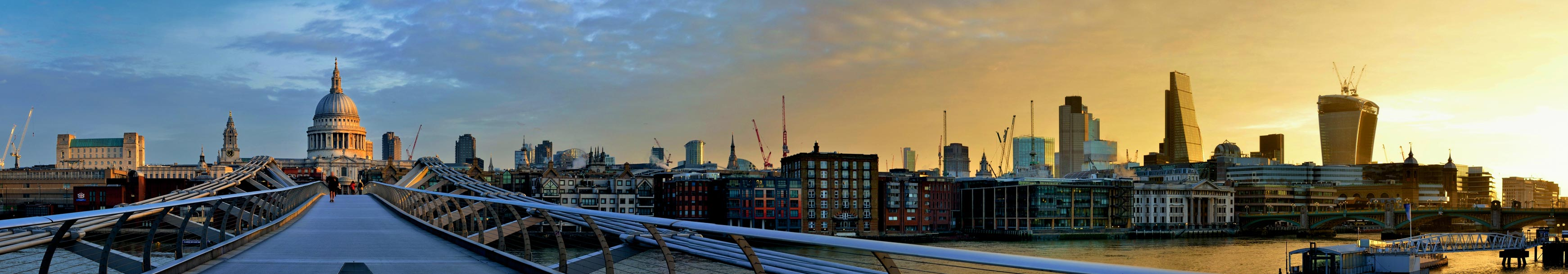 The London skyline at Millennium Bridge