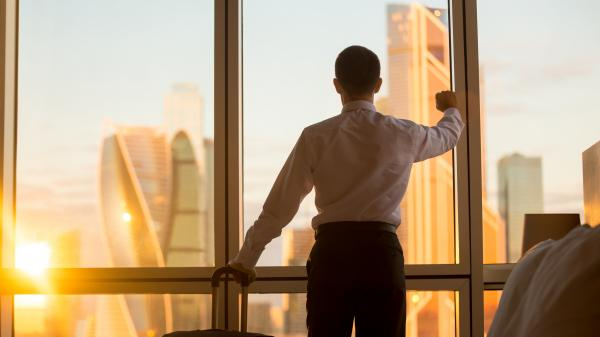 Business man looking out office window